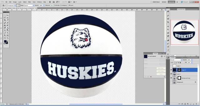 Using the Paint Bucket Tool, click on the image to flood the masked selection with the color