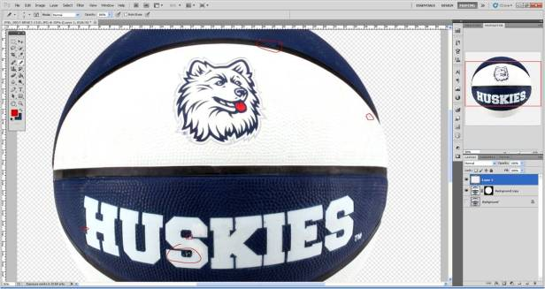 Make any major cosmetic edits (i.e. uneven lines, folds in the logo) on a new layer.